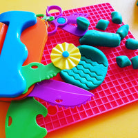 multi tool shown with playdough on mat