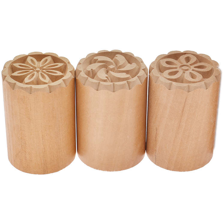 3 cylindrical wooden stamping blocks
