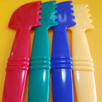 red, green, blue and yellow playdough tools for moulding