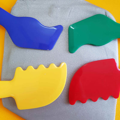 4 moulding tools shown on silver Pearl Dough