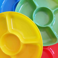 Four invitation to play trays stacked