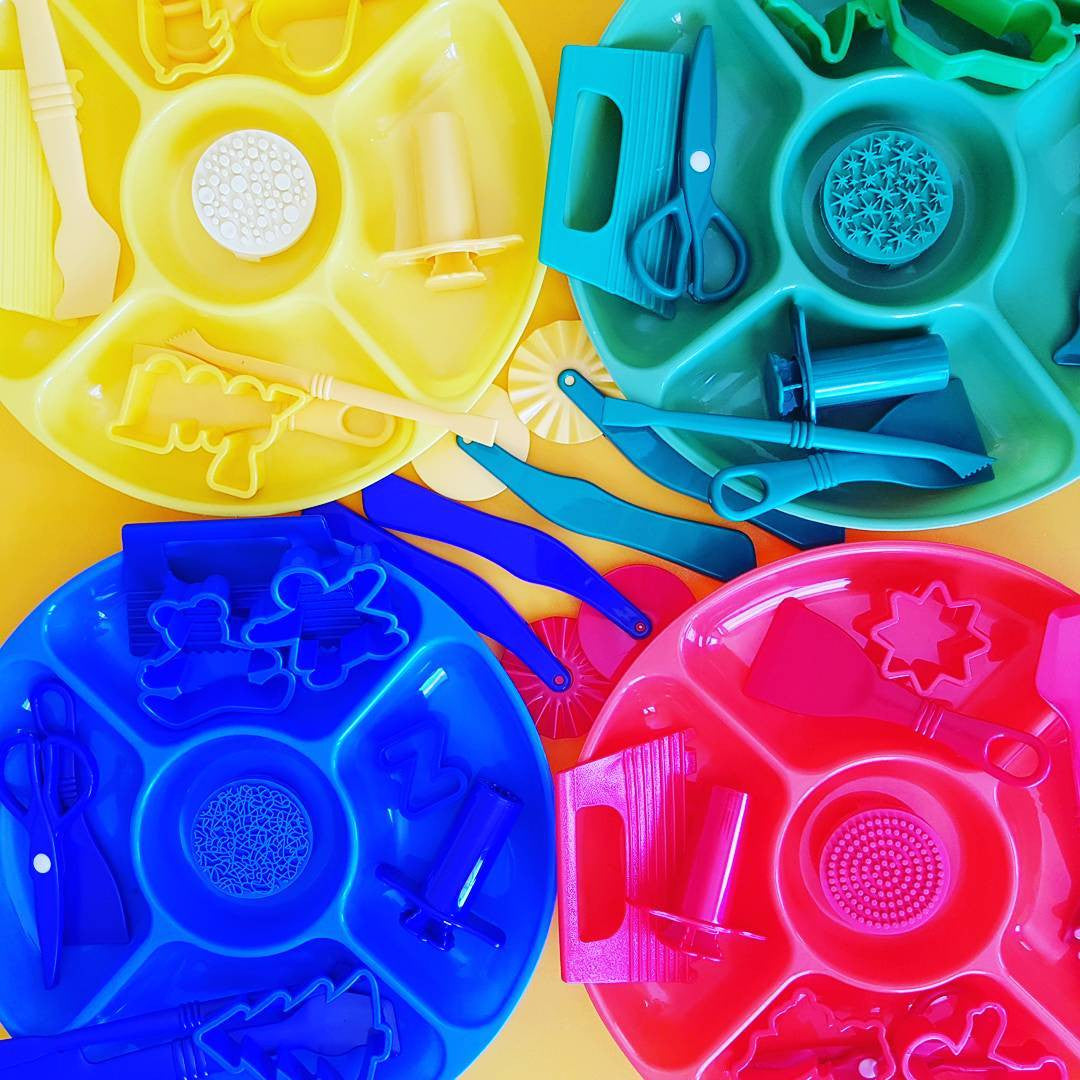Four invitation to play trays with playdough tool contents