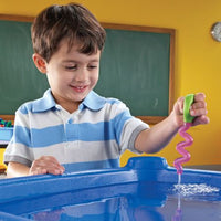 boy playing with dropper in water