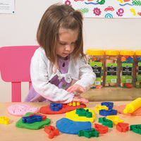 Girl playing with playdough accessory kit