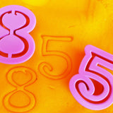 numbers 8 and 5 stamped into playdough