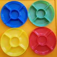 Four invitation to play trays in blue, green, yellow and red