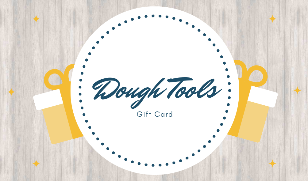 Dough Tools Gift card. Wooden-style background picture with yellow gift boxes.