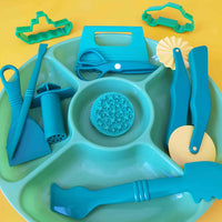 green invitation to play tray with contents