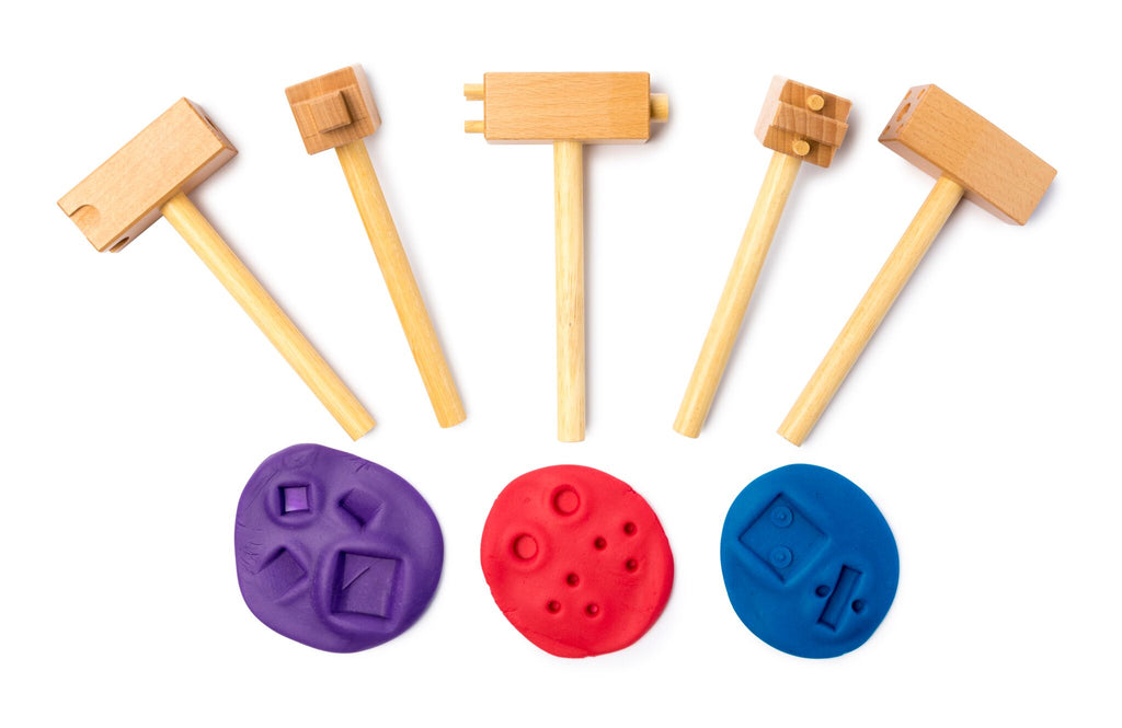 5 wooden hammers shown with imprints in playdough