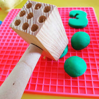 hammer shown flattening playdough