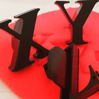 Letters X Y and Z stampers shown in red playdough