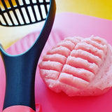 potato masher shown with pink playdough