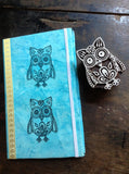 Owl stamp shown on journal cover