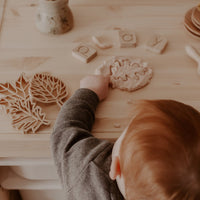 child playing with playdough and cutters