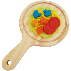 board shown with playdough pizza