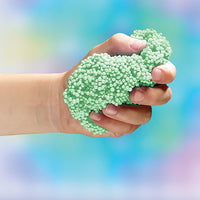hand with green playfoam