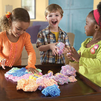 three children share a large amount of playfoam