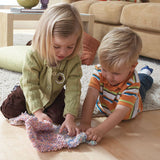two toddlers play with playfoam