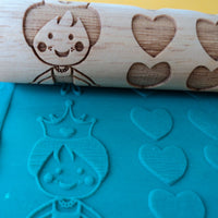 patterned rolling pin with blue playdough