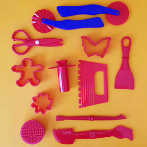 collection of red playdough tools