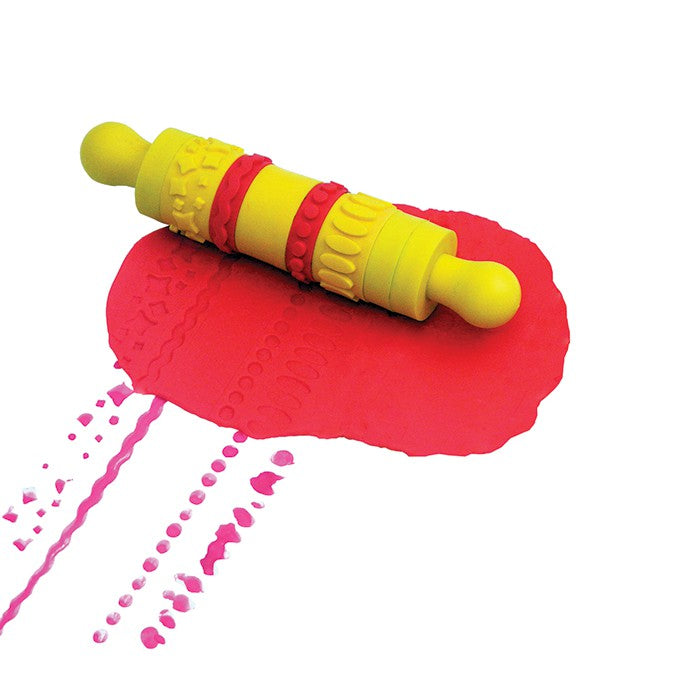 yellow and red pattern roller shown with red playdough