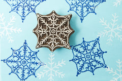 Snow flake design on a Rosewood stamp