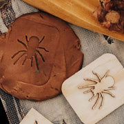 spider stamp with brown dough