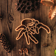 jumping spider dough cutter shown on wood with natural plants