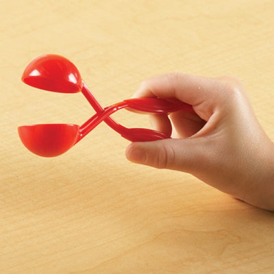 Red tweezers shown in child's hand