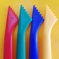 red, green, blue and yellow craft stick tools