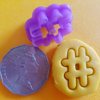 hashtag playdough cutter shown with 50 cent coin