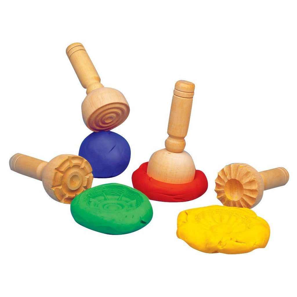 Set of 4 wooden stampers shown with dough
