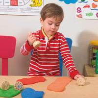 boy playing with stamper and dough