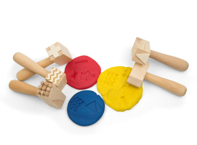 Wooden hammers shown with dough