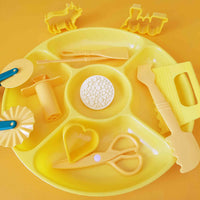 yellow invitation to play tray with contents
