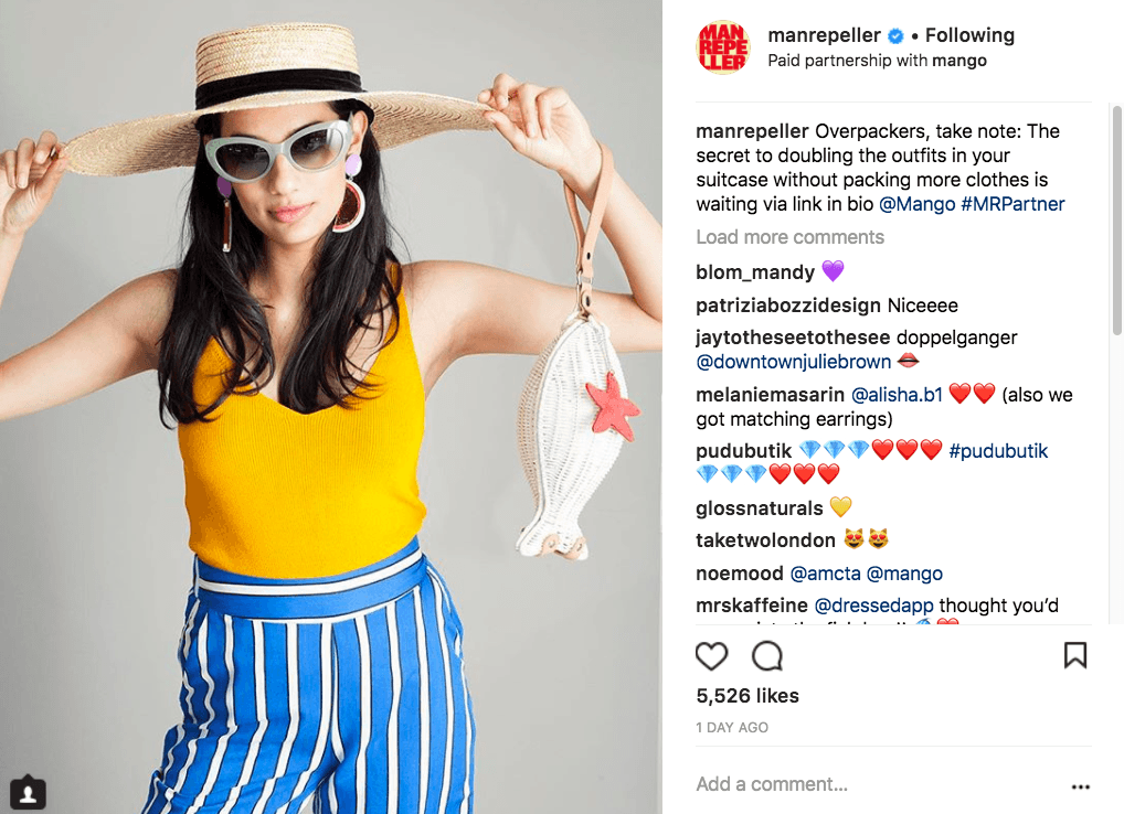 man repeller instagram post of woman wearing yellow tank top and blue and white striped pants