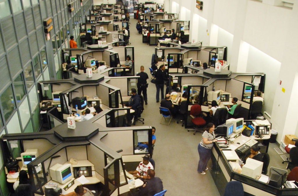 Birdseye view of people working in office cubicles