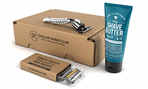 Dollar shave club subscription box featuring a razor, raxor blades, and shave butter