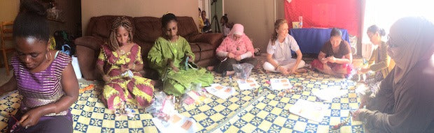 Female artisans sitting on a floor making products for GAIA