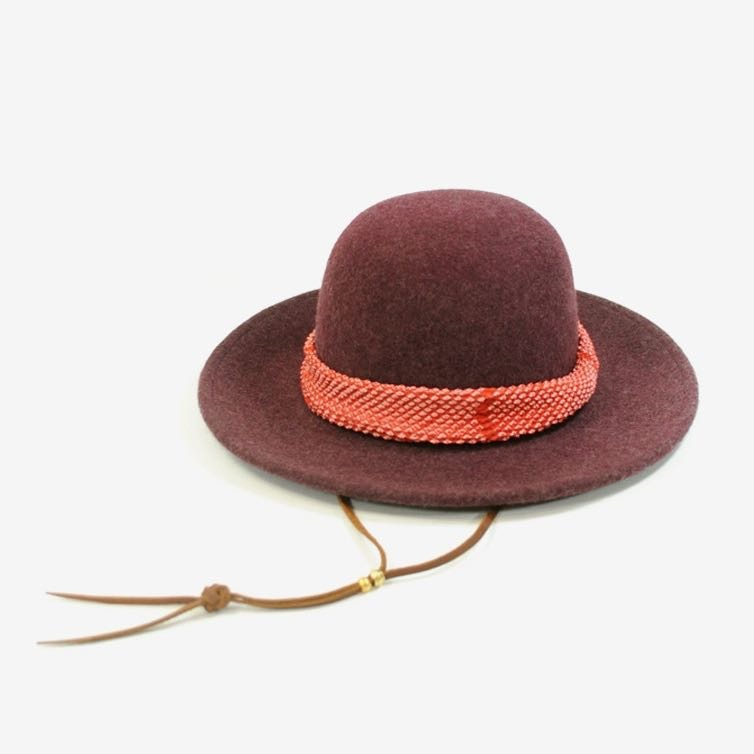 An upcycled burgundy wool hat from Kiriko