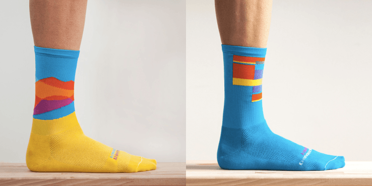 two Ornot socks, blue and yellow on left and blue on right