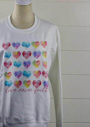 'Love Never Fails' Graphic Sweatshirt