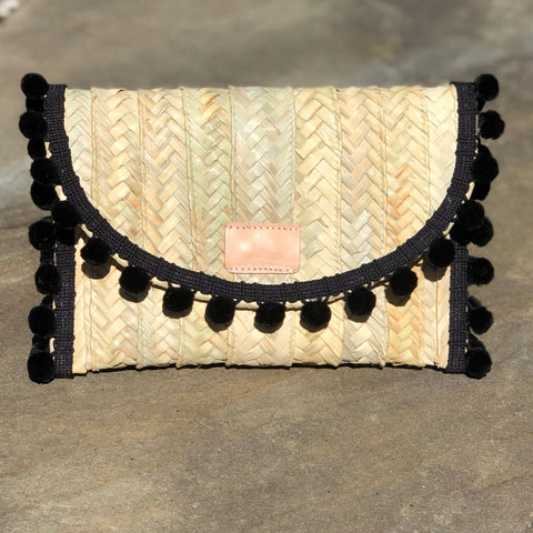 Penelope Black Pom Pom Trim Straw Clutch