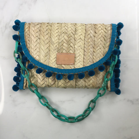 Penelope Teal Pom Pom Trim Straw Clutch