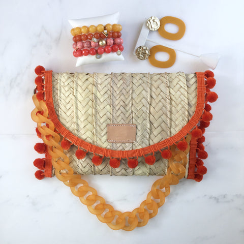 Penelope Orange Pom Pom Trim Straw Clutch