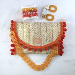Penelope Orange Pom Pom Trim Straw Clutch - Oriana Lamarca LLC