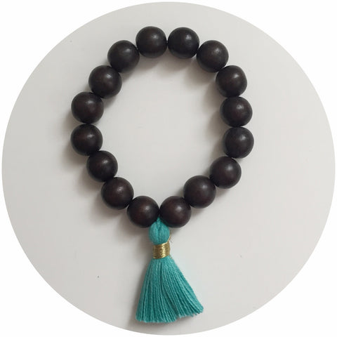 Ebony Wood with Turquoise Tassel