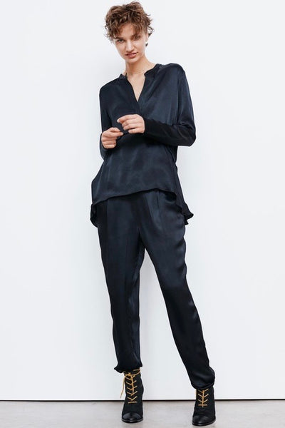 Rabens Saloner Cristelle Pant has a relaxed timeless feel and so easy to style up or down for any occasion. Stunning and simple these pants feature side pockets with flat front and drape, gathered elasticated back that falls to a long, straight leg with cuffed hems.  100% Viscose