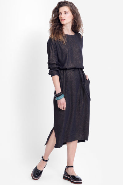 ELK Espen Dress is casually elegant and so versatile. Slim straight fit with longer length sleeves, removable tie at waist, short side splits and front side pockets. Metallic fleck fabric which is soft and drapes beautifully on the body. Perfect for more formal occasions or easily dress down with your favourite trainer or ankle boots.  100% Viscose Hand wash
