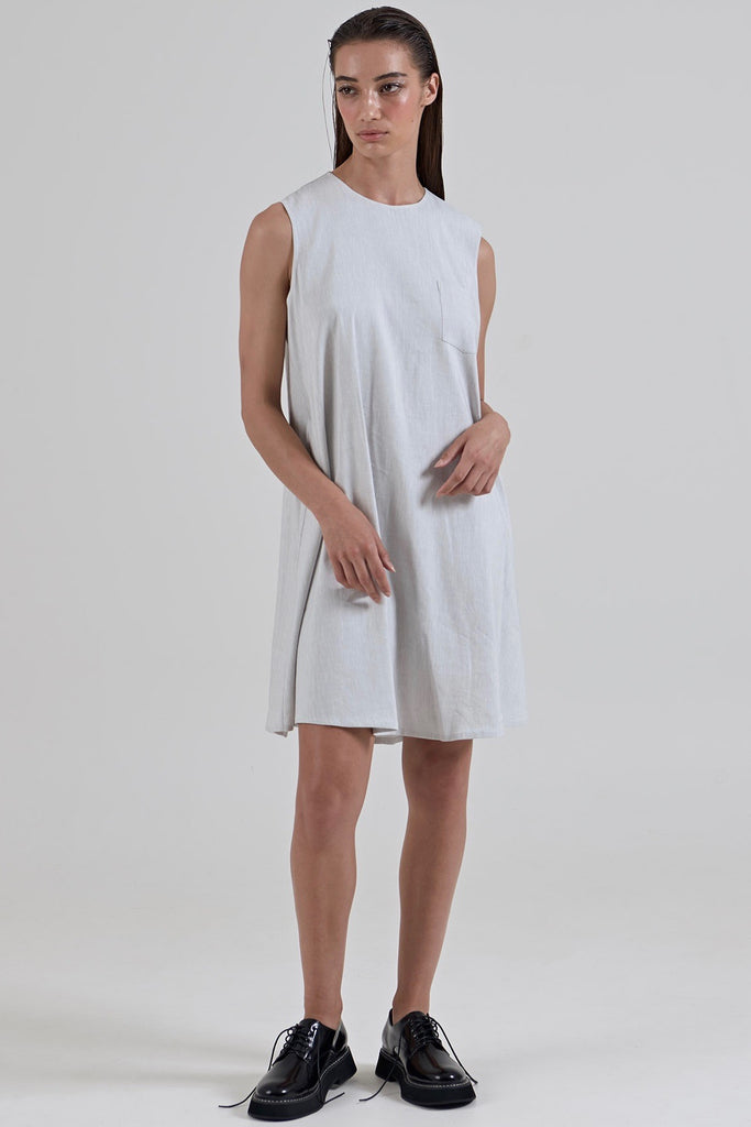 Garth Cook Water Cooler Dress is a beautifully constructed garment with french seams. This dress features an open back which fastens at the nap of the neck with a hook and eye closure, internal tie belt can be worn multiple ways to change the drape of the dress, and a shirt front patch pocket.  55% Linen 42% Viscose 3% Spandex Hand wash in warm water Designed and crafted in Australia